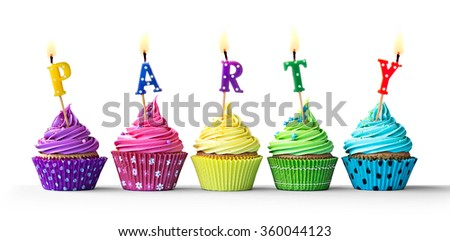 Row of colorful party cupcakes isolated on a white background - stock photo