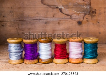 row of colorful sewing thread - stock photo
