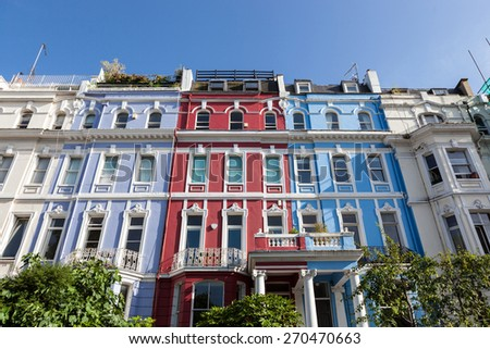 Row of colourful Victorian terrace houses - stock photo
