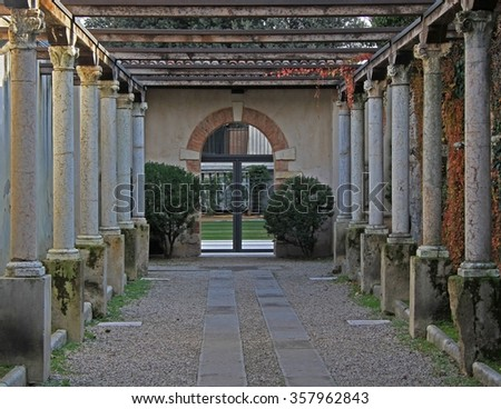 row of column on the entrance to museum in Verona, Italy - stock photo