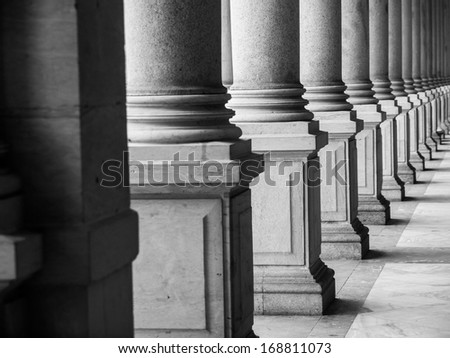 Row of columns in black and white (Karlovy Vary, Czech Republic) - stock photo