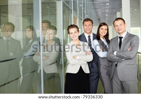 Row of confident business group looking at camera - stock photo