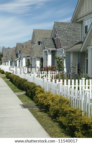 Row of Contemporary Homes With Yards - stock photo