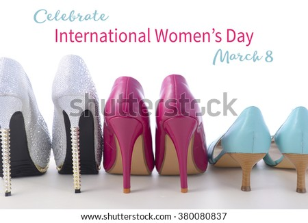 Row of different pairs of shoes symbolizing different women for International Womens Day, March 8.  - stock photo