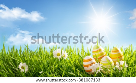 Row of Easter Eggs with Daisy on Meadow - stock photo