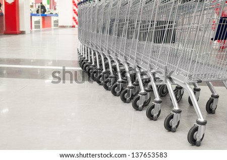 row of empty big cart in the supermarket - stock photo