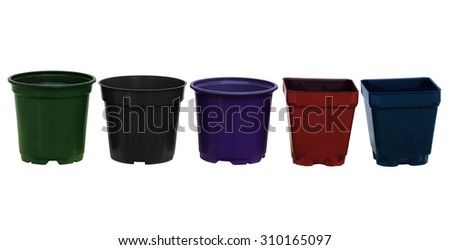 Row of empty flower plant pots in different shapes and colors - stock photo