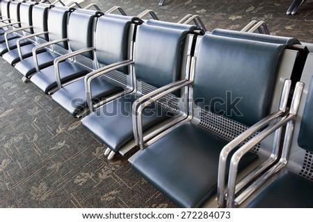 Row Of Empty Seats Inside Airport - stock photo