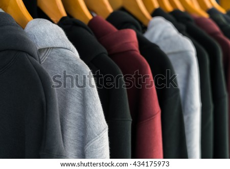 Row of Fashionable clothing on hangers - stock photo