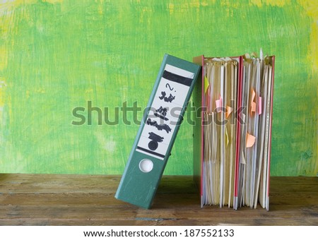 row of file folders with messy documents, free copy space - stock photo