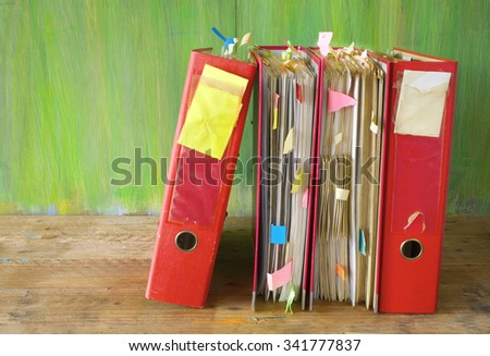 row of file folders with messy documents,free copy space - stock photo