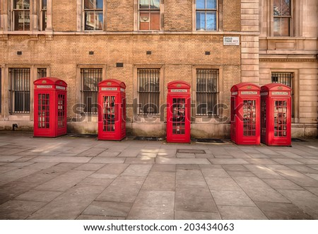 row of five classic K2 phone boxes in Covent Garden at Broad Court - stock photo