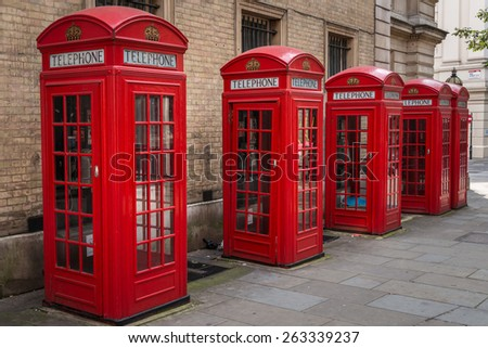 Row of five traditional red K2 type telephone boxes in central London, UK near Covent Garden. - stock photo