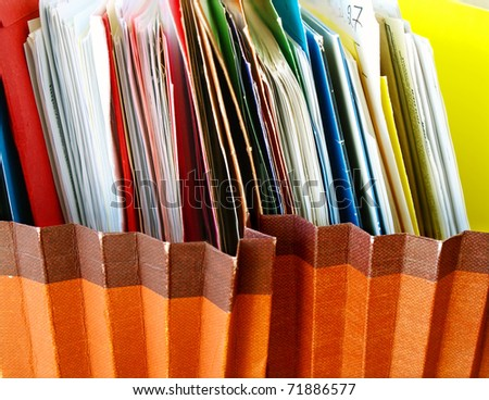Row of folders in expending file pockets - stock photo
