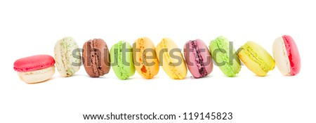 row of french multicolored  macaroons isolated on white background - stock photo