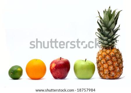 Row of fresh ripe fruits isolated on white background - stock photo