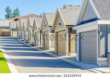 Row of garage doors in Vancouver, Canada. - stock photo