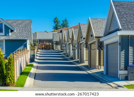 Row of garages in the back alley. North America. Canada. - stock photo