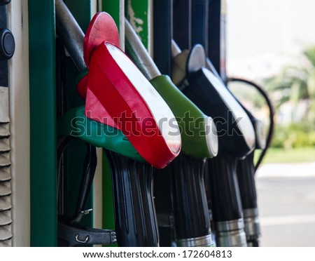 row of gas station pupmps close up - stock photo