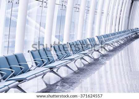 row of green chair at airport - stock photo