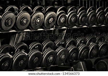 Row of Hand Barbells weight training equipment - stock photo
