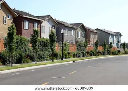 Row of houses in suburban neighborhood - stock photo