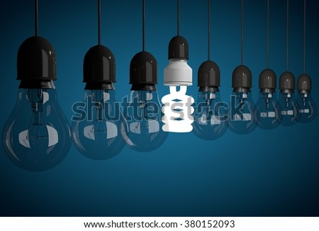 Row of incandescent dark bulbs lit by one energy saving bulb - stock photo