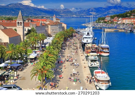 Row of leisure boat anchored along sunny harbor of old Venetian town, Trogir, Croatia - stock photo