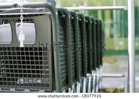 Row of luxury shopping carts. Selective focus - stock photo