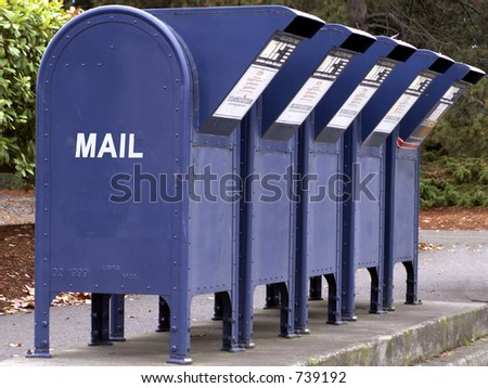 Row of mail boxes awaits letters. - stock photo