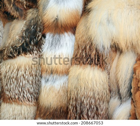 Row of many fur coats of different colors - stock photo