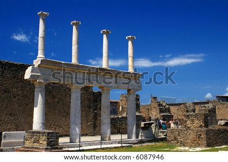 Row of marble columns at famous ancient town Pompeii, Italy - stock photo