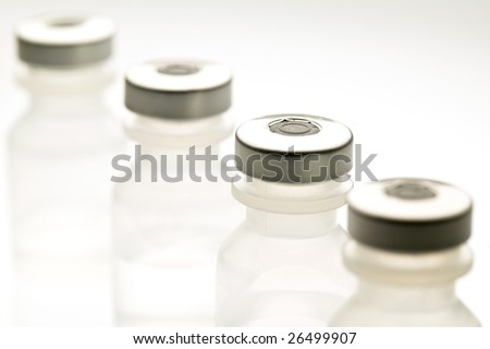 Row of medical vials containing saline solution - stock photo
