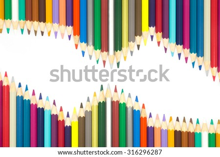 Row of mixed colors wooden pencils on white background - stock photo