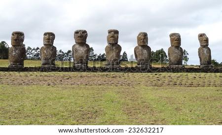 Row of moai status at Ahu Akivi. Easter Island, Chile. Rapa Nui - stock photo