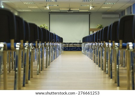 Row of Modern Chairs Standing in Line in The Empty Auditorium. Horizontal Image Composition - stock photo
