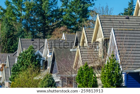 Row of modern houses in great neighborhood, in suburbs of Vancouver, Canada. - stock photo