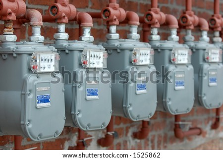 Row of Natural Gas Meters at Apartment Complex - stock photo