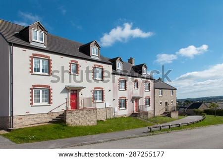 Row of new terraced houses - stock photo