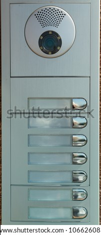 Row of non numbered door bell buttons with microphone and camera - stock photo