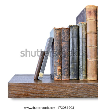 Row of old books on a wooden shelf - stock photo