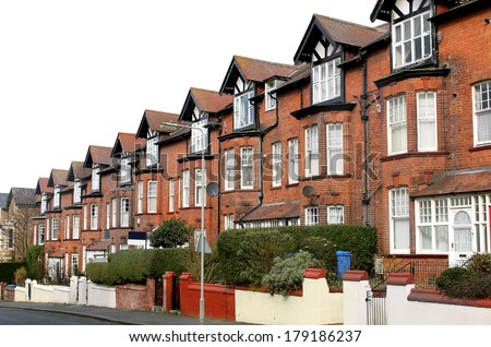 Row of old terraced houses on a street, Scarborough, England. - stock photo