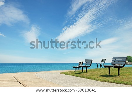 row of park benches - stock photo