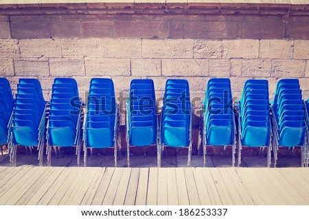 Row of Plastic Chairs near the  Wooden Stage, Instagram Effect - stock photo