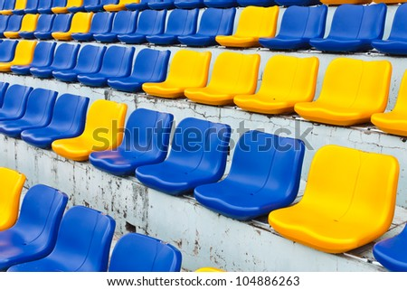Row of plastic seats at stadium - stock photo
