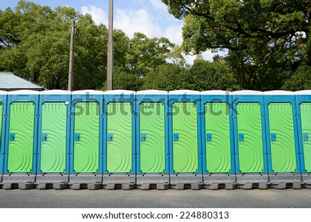 row of portable toilets for outdoor - stock photo