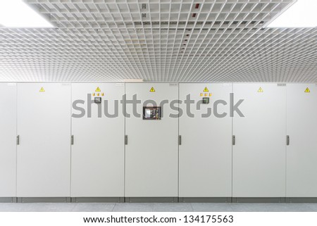 Row of racks with equipment for telecom. - stock photo