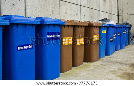 Row of Recycling and Garbage Cans lined up - stock photo
