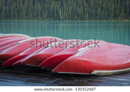 Row of red canoes, Banff National Park, Canada - stock photo