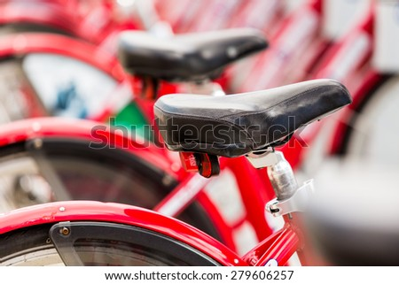 Row of red rental bikes at the Union Station in Denver, Colorado. - stock photo